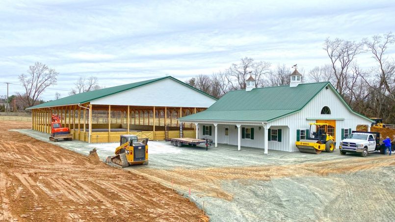 Horse arena with attached barn front view