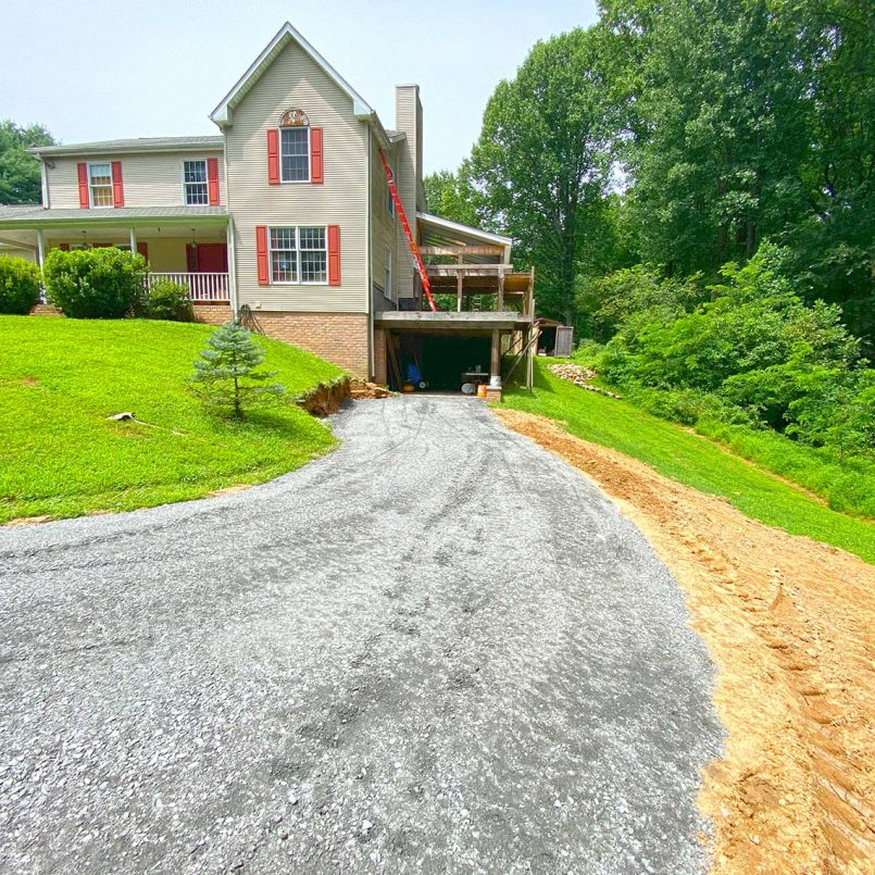 Completed gravel driveway with leveling and grading