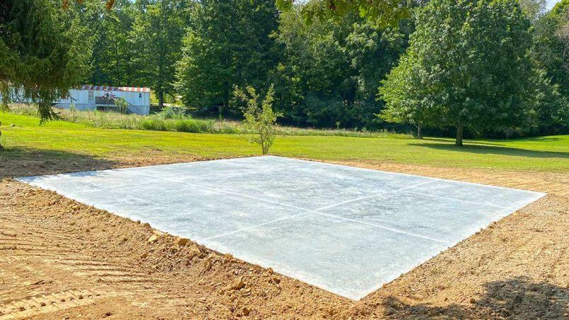Graduated concrete pad surface