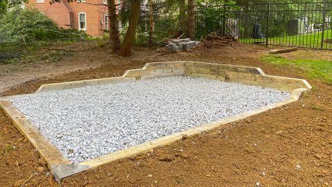 Signature stone base foundation with corner retaining wall