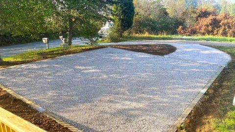 Signature stone base foundation integrated into driveway extension